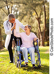 cheerful senior patient doing high-five with caregiver