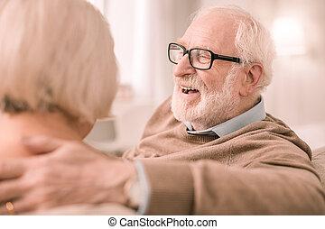 Cheerful senior people spending weekend at home