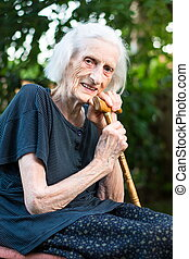 Cheerful senior woman with a walking cane