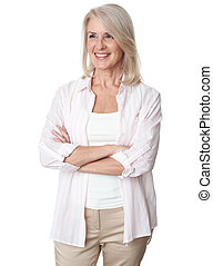Cheerful senior woman with hands folded is looking away. Isolated
