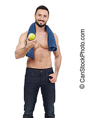 Cheerful shirtless man with apple