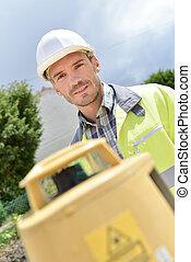Cheerful site surveyor