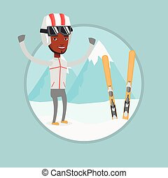 Cheerful skier standing with raised hands.