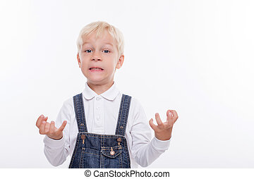 Cheerful small boy is expressing his negative emotions