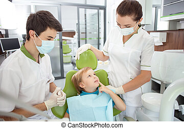 Cheerful small male child came to visit dentist