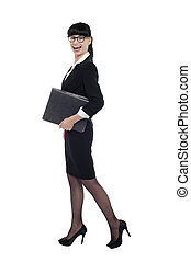 Cheerful smart business lady walking with files