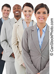 Cheerful smiling business team standing together