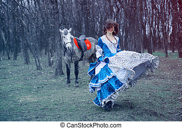 cheerful smiling girl walking with a horse