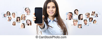cheerful smiling woman showing blank smartphone screen, with person in background. social network concept
