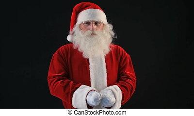 Cheerful snowfall - Playful Santa cheerfully throwing...
