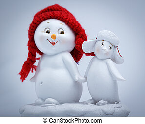 Cheerful snowman and penguin dancing