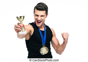 Cheerful sports man holding winner cup