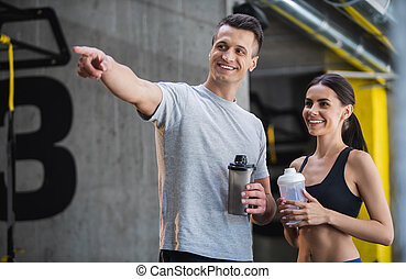 Cheerful sporty couple is spending active time jointly -...