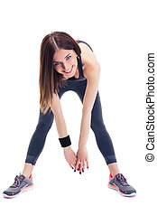 Cheerful sporty woman doing stretching exercise