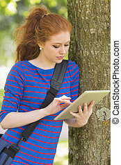 Cheerful student leaning against a