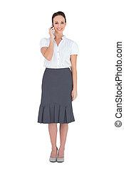 Cheerful stylish businesswoman on the phone