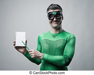 Cheerful superhero with notebook
