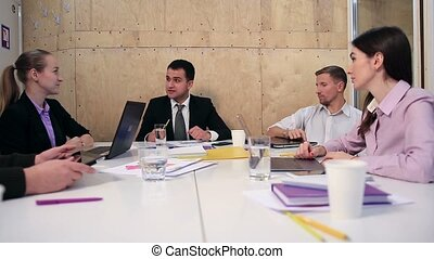 Cheerful team of business people in meeting room