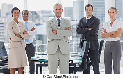 Cheerful team of business people posing together