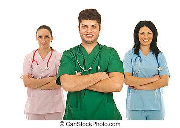 Cheerful team of three doctors