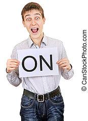 Cheerful Teenager hold slogan ON