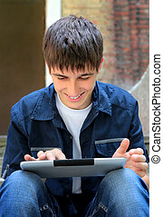 Teenager with Tablet Computer