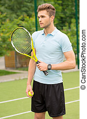 Cheerful tennis player ready to compete