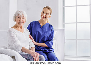 Cheerful therapeutic speaking physical condition of patient