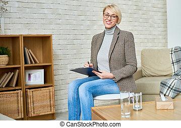 Cheerful therapist in nursing home