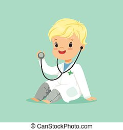 Cheerful toddler boy in white medical gown playing doctor...