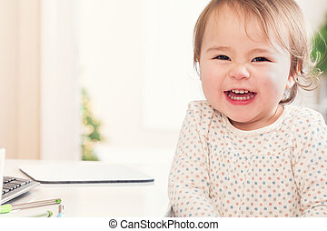 Cheerful toddler girl with a huge smile
