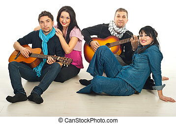 Cheerful two couples with guitars