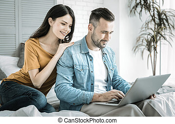 Cheerful two friends searching web