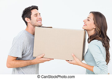 Cheerful woman and her husband holding a box