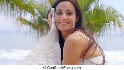 Cheerful Woman at the Beach Looking at the Camera