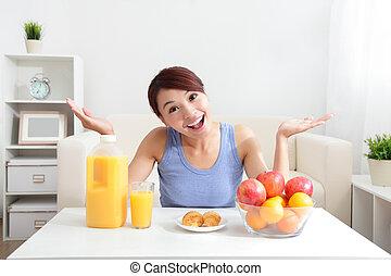 Cheerful woman drinking an orange juice