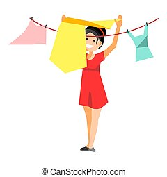 Cheerful woman drying clothes - Smiling woman putting...