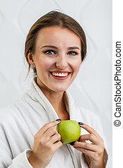 Cheerful Woman Enjoys Apple