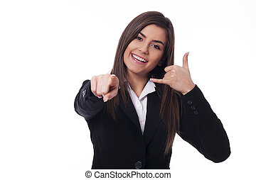 "Cheerful woman gesturing ""call me"""