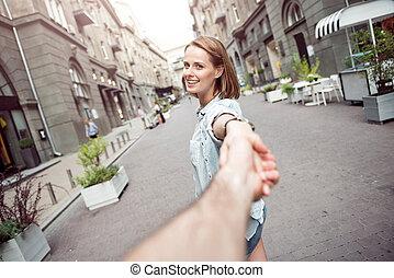 Cheerful woman having a walk with her boyfriend