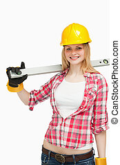 Cheerful woman holding a spirit level