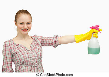 Cheerful woman holding a spray bottle