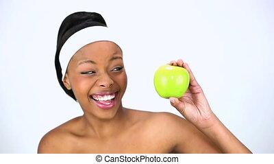Cheerful woman holding apple