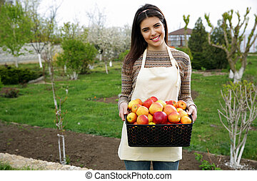 Cheerful woman holding basket with