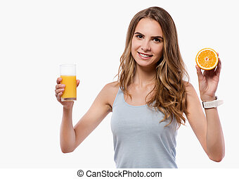 Cheerful woman holding orange