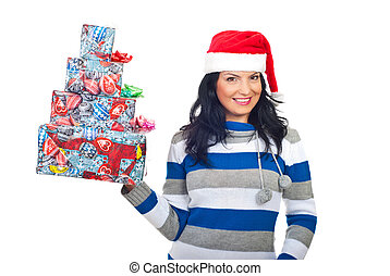 Cheerful woman holding stack of Christmas gifts