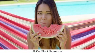 Cheerful woman in bikini eating watermelon slice - Cheerful...