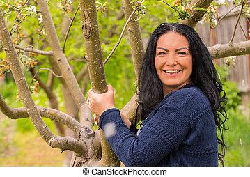 Cheerful woman in garden