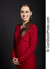 Cheerful woman in red dress