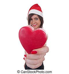woman in Santa hat holding a heart